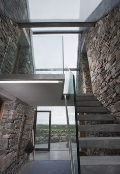 Gallery of Connemara / Peter Legge Associates 15 2019 Connemara / Peter Legge Associates. Glass walls and concrete stairs join the two buildings. The post Gallery of Connemara / Peter Legge Associates 15 2019 appeared first on Architecture Decor. Stone Cottages, Stone Houses, Beach Cottages, Architecture Design, Architecture Ireland, Futuristic Architecture, Beach Houses For Rent, Balustrades, Concrete Stairs