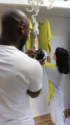Choosing the pieces for the shoot, backstage london photo shoot, camera canon