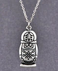 Girls just love dolls – especially the Babushka Doll Necklace. This lovely accessory is made up of a darling 1-inch tall Babushka doll charm with lovely etchings hoisted by a simple 9-inch silver c...
