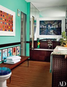 Entrepeneur and designer Lapo Elkann's Milan bath is filled with incredible artwork from top talents such as Damien Hirst.