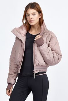 This Adidas by Stella McCartney puff jacket features an oversized collar and ribbed thumbholes fo...