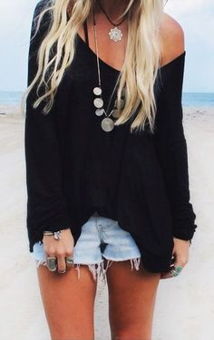 #beachfashion #blacksweater // Stay warm on those late night beach trips with a black knit sweater and light wash denim shorts.