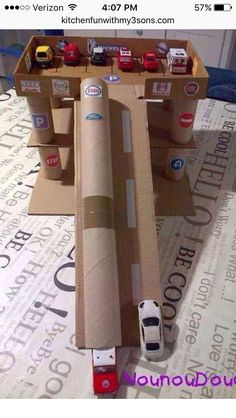 Car garage & ramp play Summer crafts from cardboard box, cereal box, paper towel roll, etc....