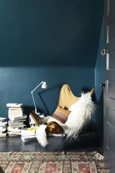 The wall colour is Benjamin Moore Dark Harbor and the floors and trim are Benjamin Moore Soot.