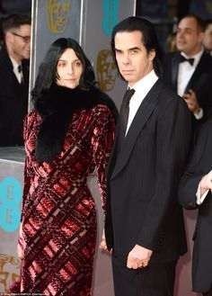 Nick Cave's wife Susie Bick wore interesting dress but forgot entirely to do her hair.  The hair fails her.