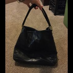 Coach Black Pebbled Leather Bag Coach Black Pebbled Leather Hobo. Has 3 compartments with magnet close and middle zippered pocket great for keep your wallet secured Coach Bags Hobos