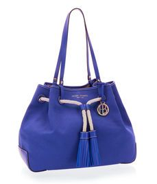 Whether seriously shopping or browsing with patient sass, the Canvas Shopper is the ideal luxury handbag for your outing: crafted with durable and delectable canvas with fine leather and flirty rope finishing trims, this designer bag is carried by the Bendel Girl who knows she's always the thing to be admired.