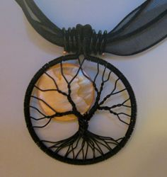 An October Night Tree of Life by Mariesinspiredwire on Etsy, $25.00