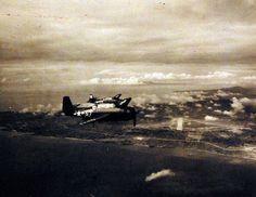 80-G-331003: TBM's from USS Block Island (CVE 106) flying over Yontan Airfield on West Coast of Okinawa, Ryukyus, 20 May 1945.