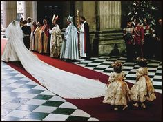 Lovely little flower girls follow the 25 ft. train on Princess Diana's wedding gown.