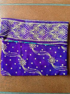 This handmade purse is designed to hold treasures of all kinds.   It can be used to help organize your purse or backpack keeping small items in a discrete yet fashionable pouch. You can find this bag and more at easy.com justincasegifts