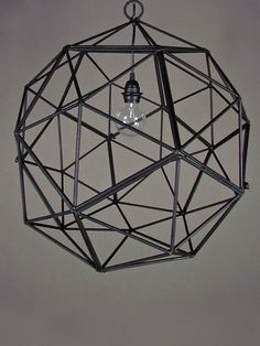shapely harmony wondering how to add a bit of geometry to square rooms? the bakey street orb light, angled on all ends, adds interest from every perspective. made from the artistic melding of steel pentagons, thisblack metal pendant light blends the best of minimalist art with mathematical intrigue. made in the USA.
