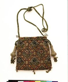 """1600-1650 English Purse at the Victoria and Albert Museum, London - From the curators' comments: """"In the 17th century, decorative purses such as this own were rarely used to carry money. Their wealthy owners engaged in few commercial exchanges requiring cash. In addition to serving as 'sweet bags' or 'gift wrapping', purses sometimes contained mirrors for grooming. Others functioned as sewing kits, holding needles, thread and tiny scissors."""""""