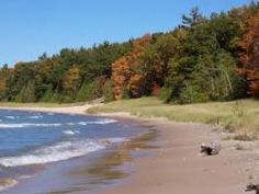 Barnes County Park is just north of Elk Rapids and is a beautiful campground. It seems more rustic, but does offer electric hookup.  The beach of Lake Michigan is spectacular too.  I recommend visiting during Elk Rapid's Harbor Days in early August.