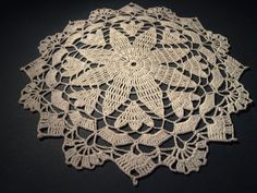 Small crochet doily with star pattern by Handicraftshed on Etsy, €4.00