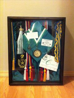 Remember: when creating your shadow box, really place things in that you're proud of and that you've really worked hard to accomplish. All my chords and academic metals were a major goal of mine to obtain. I threw in a quote that one of my senior composition teachers had shared with us every Fridays, a card size of my diploma, and an invitation to show it off a little.
