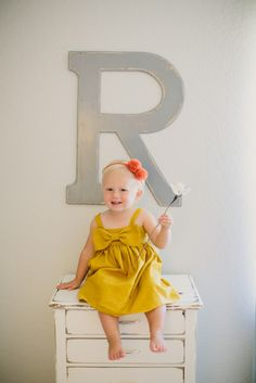Adding your child's initial makes the space extra special!