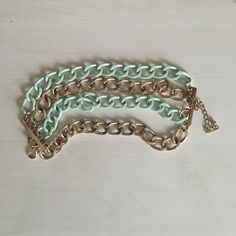 Chain link bracelet Mint green and gold colored chain bracelet. Loose fit with adjustable clasp. Francesca's Collections Jewelry Bracelets