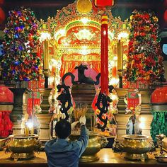 #temple attendants tend to incense offerings keeping things tidy for the gods. #light shimmers through the hall like midnight constellation. #hongkong #chinese #spirituality #travel #travelgram #traveling #travelphotography #asia #poet #poetry