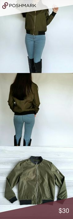 Olive Green Cropped Bomber Jacket Olive green cropped bomber jacket. Very comfortable and light weight. 60% nylon, 40% polyester. Brand new. Comes in sizes S-M-L. True to size. I'm 5'2 modeling a size small. No trades, no paypal. Price firm unless bundled. Jackets & Coats