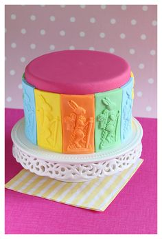 Colourfull Easter bunny cake. The bunnies are made with a springerle mould. I used different colours of rolled fondant.