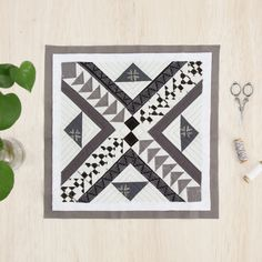"Give your quilts that unique touch with the style you enjoy, for example, this ""Pathway"" block was created in 2 completely different colorways to show you that with a mix of bold/tribal prints, you can achieve a boho look! Swipe left to see a monochromatic version of this block, using grayscale toned fabrics for a more modern effect. It's important to note that no matter what style you choose, keep in mind the placements of light and darks for contrast to accomplish the look!"