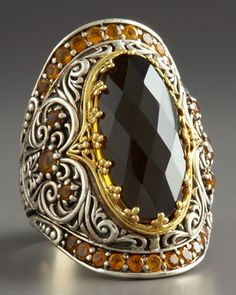 warm quartz and citrine Konstantino ring is constructed of luminous sterling silver and yellow gold that's embellished with baroque carving to evoke a precious, heirloom sensibility.