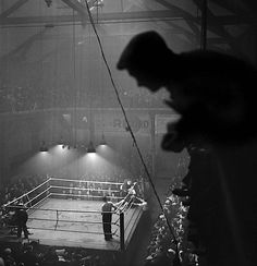 Gaston Paris - Boxing match, France, 1937-1938. | boxing gloves | box | Ali | black  white | vintage | smokey | boxing ring | crowd