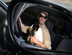 Cyclone Cab driver Mike Seronko poses in his car with Baby Girl, his rat terrier dog. Photo by Nirmanedu Majumdar/Ames Tribune