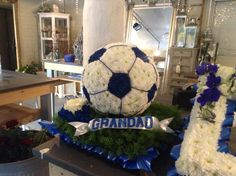 Funeral Flowers. football funeral flower tribute, chelsea football funeral flower tribute, bespoke funeral flowers, unusual funeral flowers www.thefloralartstudio.co.uk