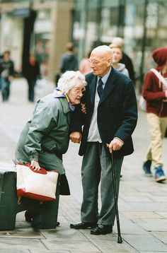 I seem to focus on old people more than any other when I'm photographing in the streets, purely because they have such character, and also for sweet moments like this were an elderly man is helping his wife stand up, so sweet <3. Canon EOS-1, expired film.