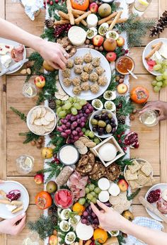 Learn how to set up a big table of cheese and decorate it with baked goat cheese balls, fruit and other edible goodies for the holidays.