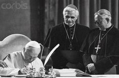 A rare photograph of John Paul II with two men who would succeed him as Pope, Cardinal Ratzinger, who became Benedict XVI, and Cardinal Bergoglio
