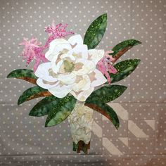 16th and Baltimore quilt, Block 4, at Eye Candy Quilts. Magnolia and feathery astilbe, with a reverse applique lace-inspired handle.