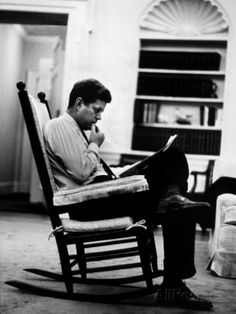 President John F. Kennedy Sitting Alone, Thoughtfully, in His Rocking Chair in the