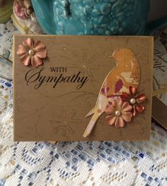 Sympathy card. A simple card using an embossing folder to make a background to the card base. Add a sentiment, die cut bird and flowers.