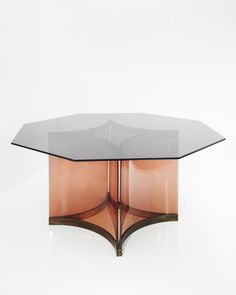 Alessandro Albrizzi | smoked-glass top octagonal dining table with perspex base in smoked rose and brass
