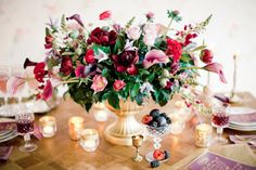 Berry colored floral centerpiece | Anastasiya Belik Photography | http://burnettsboards.com/2013/12/mixed-berry-wedding-color-palette/