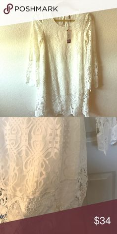 Bohemian White Laced Dress 70% cotton. 40% nylon. Cont 100% poly. Lining 100% poly. Dresses Long Sleeve