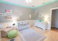 Love the pop of mint green in the crown molding in this modern, gray nursery!