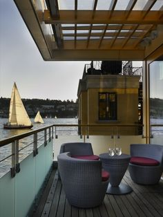 This Eco-friendly and contemporary floating home in Seattle showcases outdoor living at its finest!