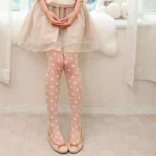 Polka dot sheer tights in white.
