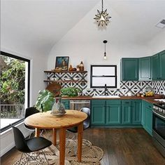 We bet that these green cabinets are more than happy to live beside this ultra-cool patterned backsplash.