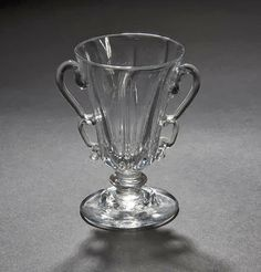 A double B-handled jelly glass, circa 1750 - The trumpet bowl with vertical ribbing, double loop B handles and moulded domed foot, high Double B, Glass Museum, Cranberry Glass, Drinking Glass, Pressed Glass, Antique Glass, Trumpet, Jelly, Old Things