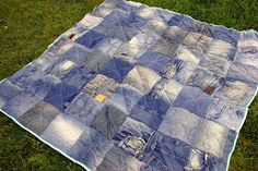 quilt made out of old jeans -- I don't quilt, but I thought this was really cute, and fabulous to take on picnics and parades -- anyone want to make one for me? ;o)
