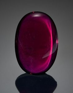 Exceptional Gem Rhodolite Garnet  East Africa   This color of garnet derives its name from rhododendron colored garnets first discovered in North Carolina in the late 1800s. Though the present gem is from more recent discoveries in Tanzania, rhodolite garnets also occur in India and Sri Lanka. The rich reddish purple hue of this cushion-shaped gem places it into the most desirable category of garnets. Both its transparency and luster are excellent