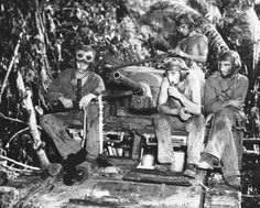 US Marine tank crew resting, after three days of battle on the front lines on Munda, Solomon Islands. 11 September 1943.