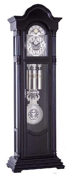 Americana Nashville model 1021 Black Grandfather Clock The Americana Nashville is a transitional, modern style Grandfather clock finished in an  Ebony black enamel with a bold four step platform base...