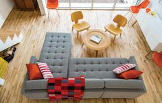 """A Dual Pebble tufted sectional by Gus Design Group for CB2 is the focal point of this living space. The maple floors are composed of inexpensive """"shorts"""" that were left over from other projects and sold at a discount."""