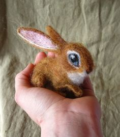 This looks so real  http://www.etsy.com/listing/72398069/baby-bunny-needle-felted-life-sized?ref=af_circ_favitem